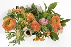 Wedding bouquet of buttercups, anemones and Ruscus Stock Photos