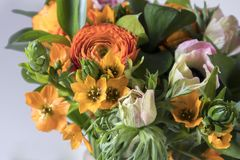 Wedding bouquet of buttercups, anemones and Ruscus Stock Photo