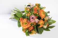 Wedding bouquet of buttercups, anemones and Ruscus Royalty Free Stock Photo