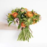 Wedding bouquet of buttercups, anemones and Ruscus Royalty Free Stock Images