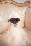 Wedding bouquet of Calla. Bouquet of purple flowers on the sof Royalty Free Stock Image