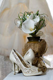 Wedding bouquet of calla lilies and bridal shoes Stock Photos
