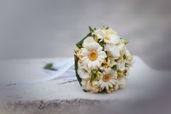 Wedding bouquet from camomiles and roses. Stock Photos