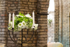 Wedding bouquet and candle holder Stock Images