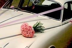 Wedding Bouquet & car. Brides bouquet on bonnet of Jaguar Wedding car Stock Photography