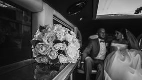Wedding bouquet in the car stock photography