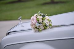 Wedding bouquet on the car royalty free stock photography