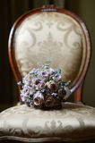 Wedding bouquet on a chair Stock Photos