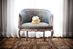Wedding bouquet on a chair Stock Photos
