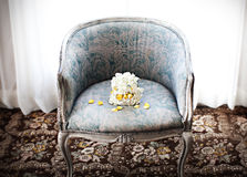 Wedding bouquet on a chair Stock Image