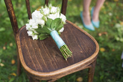 Wedding bouquet on the chair Stock Photos