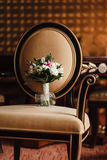 Wedding bouquet on a Chair. Wedding bouquet of flowers chair in natural light Stock Photos