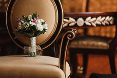 Wedding bouquet on a Chair. Wedding bouquet of flowers chair in natural light Royalty Free Stock Image