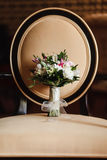 Wedding bouquet on a Chair. Wedding bouquet of flowers chair in natural light Royalty Free Stock Images