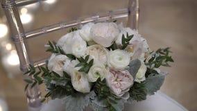 Wedding bouquet on chair. Steadicam stock video footage
