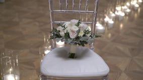 Wedding bouquet on chair. Steadicam stock footage