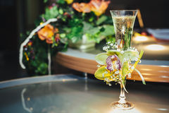 Wedding bouquet and champagne glass with flowers Royalty Free Stock Photos