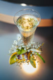 Wedding bouquet and champagne glass with flowers Royalty Free Stock Image