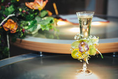 Wedding bouquet and champagne glass with flowers Stock Image