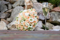 Wedding bouquet and champagne glass Royalty Free Stock Photography