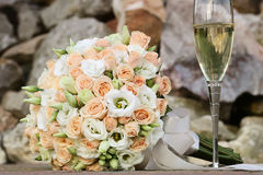 Wedding bouquet and champagne glass Stock Photos