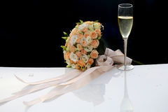 Wedding bouquet and champagne glass Stock Photography