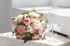 Wedding bouquet and champagne glass stock image