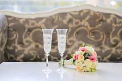 Wedding Bouquet and champagne glasses Stock Photo