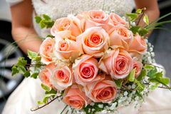 Bride bouquet. Close-up of bride holding pink roses bouquet Stock Photo