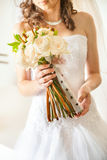 Bride bouquet. Close-up of bride holding  roses bouquet Stock Image