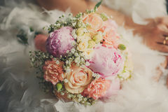 Wedding bouquet closeup at the bridal dress Stock Photography