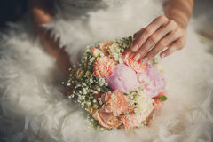 Wedding bouquet closeup in bride's hands Royalty Free Stock Image