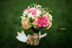 Wedding bouquet. Closeup on the grass Royalty Free Stock Photography
