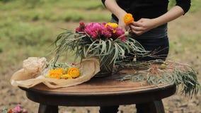 Wedding bouquet color Marsala Rustic style, Bohemian, boho style. Workshop stock video footage
