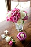 Wedding bouquet and corsage on wood table Stock Image