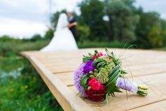 Wedding bouquet with couple unfocused Royalty Free Stock Photos