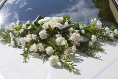 Wedding bouquet on a cowl of the white car Stock Photography