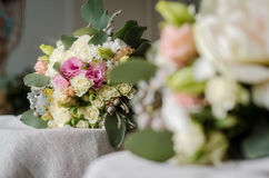 Wedding bouquet of cream roses on canvas cloth texture Royalty Free Stock Photos