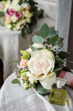 Wedding bouquet of cream roses on canvas cloth texture Royalty Free Stock Image