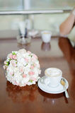Flowers and Coffee in Cafe Royalty Free Stock Images