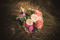 Wedding bouquet from different color roses Stock Photos