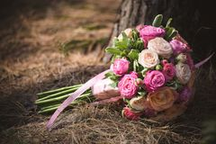 Wedding bouquet from different color roses Royalty Free Stock Photo