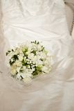 Wedding bouquet and dress Royalty Free Stock Images