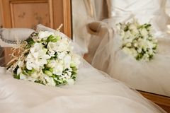 Wedding bouquet and dress Stock Photo