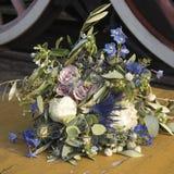 Wedding bouquet of dried flowers, eucalyptus, peony, dahlias and dolphinium Stock Image