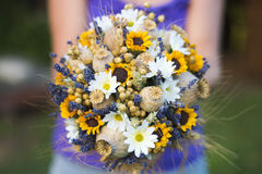 Wedding bouquet of dry flowers. Vintage wedding bouquet made of lavender,whet and sunflowers Royalty Free Stock Images