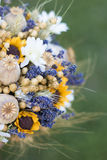 Wedding bouquet of dry flowers. Vintage wedding bouquet made of lavender,whet and sunflowers Royalty Free Stock Photography