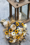 Wedding bouquet of dry flowers. Vintage wedding bouquet made of lavender,whet and sunflowers Stock Photo