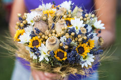Wedding bouquet of dry flowers. Vintage wedding bouquet made of lavender,whet and sunflowers Stock Photos