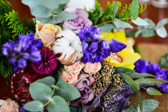 Wedding bouquet eucalyptus cotton and violet pink flowers. Royalty Free Stock Image